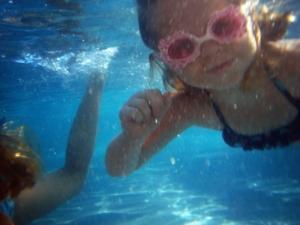 Children Swimming Underwater